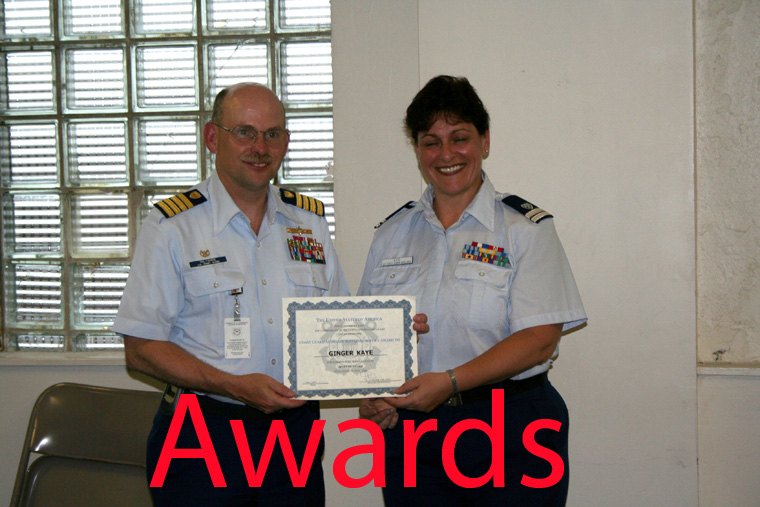 A Photo of a Auxiliary member receiving a certificate award.