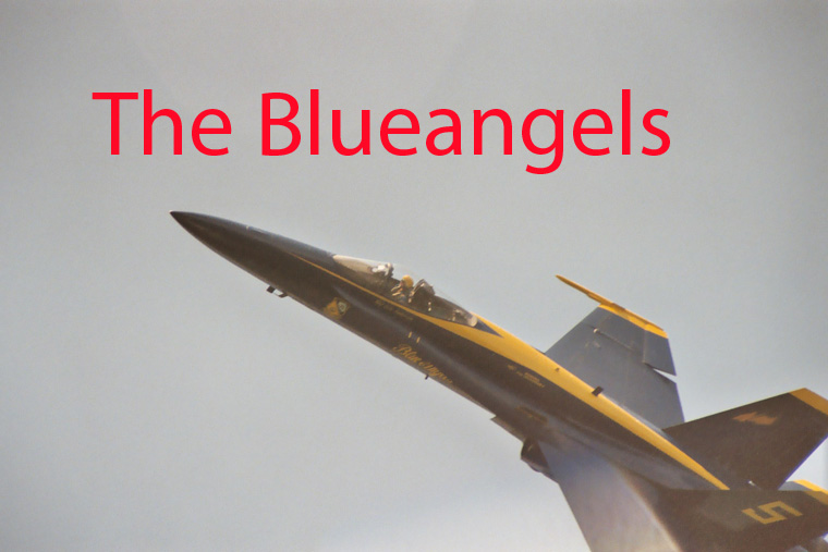 A Photo of a US Navy Blueangels Jet Flying upside down above our ship.