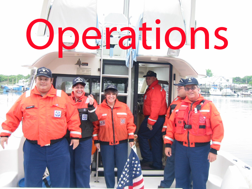 A Photo of Auxiliary members standing on a boat.